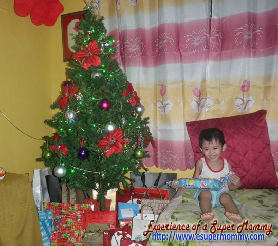 christmas tree with Cute Filipino child