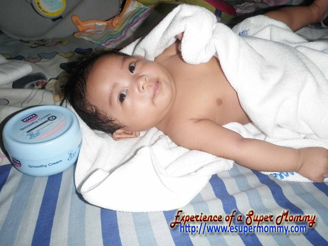 cute Filipino Baby after bath time with Nivea Baby Smoothy cream
