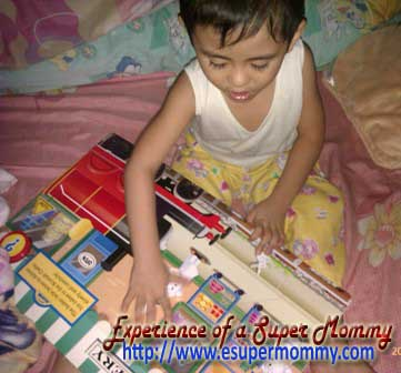 Filipino toddler reading book