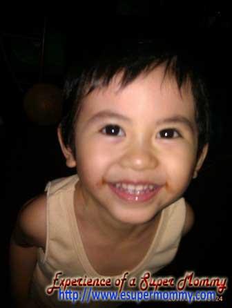 cute Filipino toddler smiles