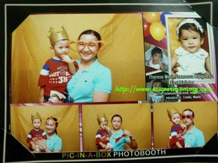 Filipino mommy and cute toddler in photo booth