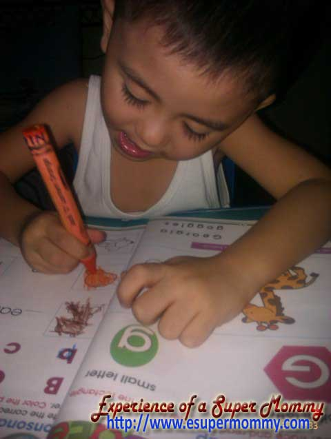 Filipino toddler writing