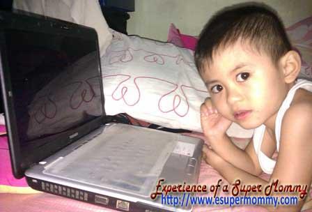 Filipino toddler using laptop