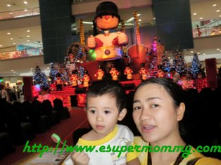 mom and baby on Christmas background